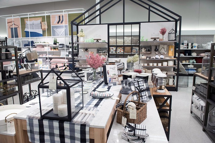 The home section of Target including tables with tablecloths and other home accessories.