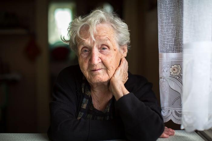 Elderly woman sitting by a window
