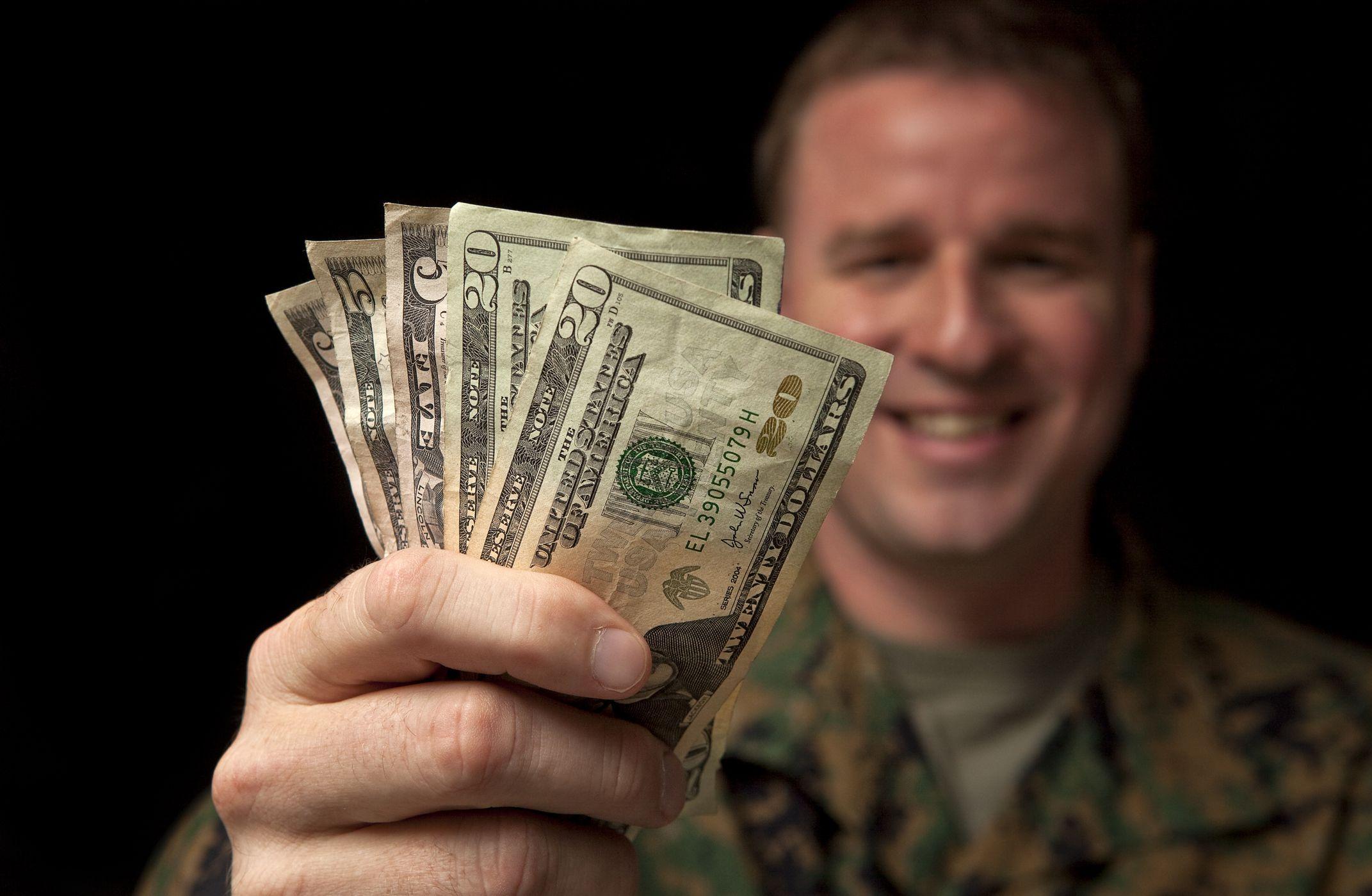 Military member holding cash