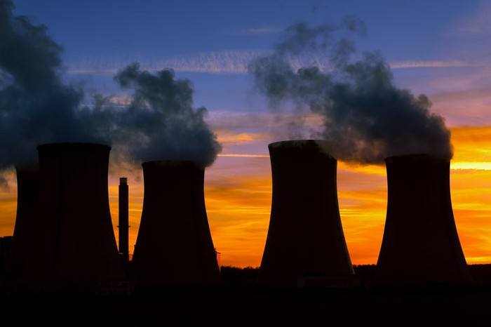 Cooling towers in silhouette.