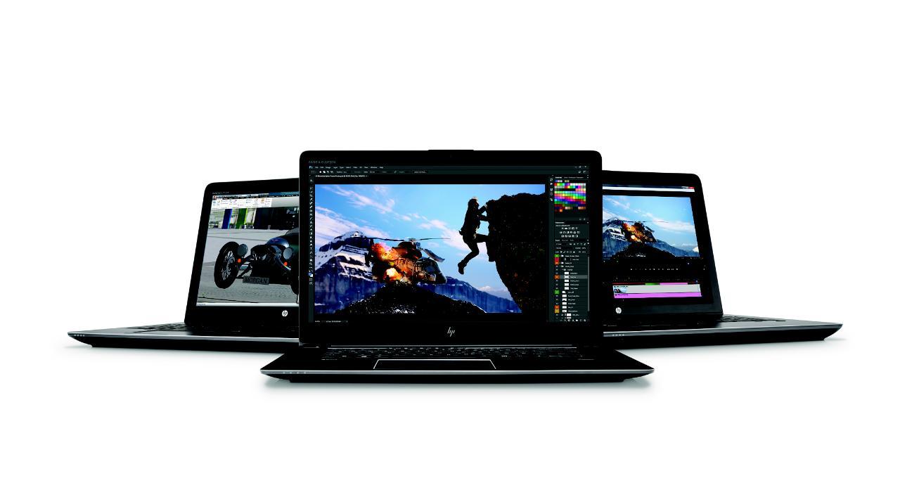 Three HP laptops.