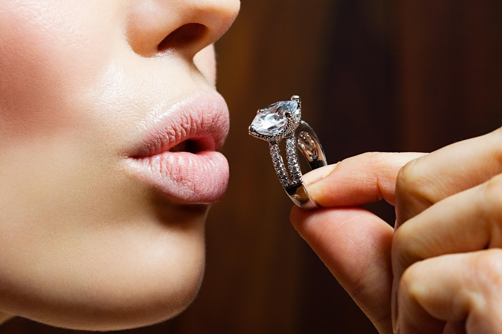 Woman kissing diamond ring