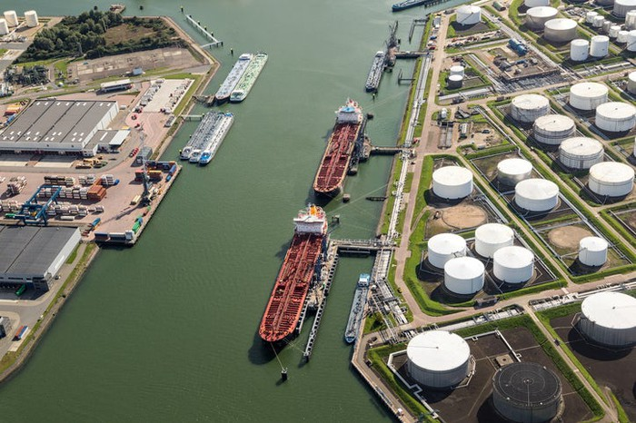 Multiple tankers getting loaded at a petrochemical trading terminal.