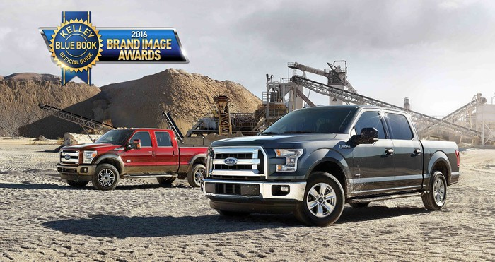 Two Ford F-150 trucks at a quarry with an award logo at upper left.
