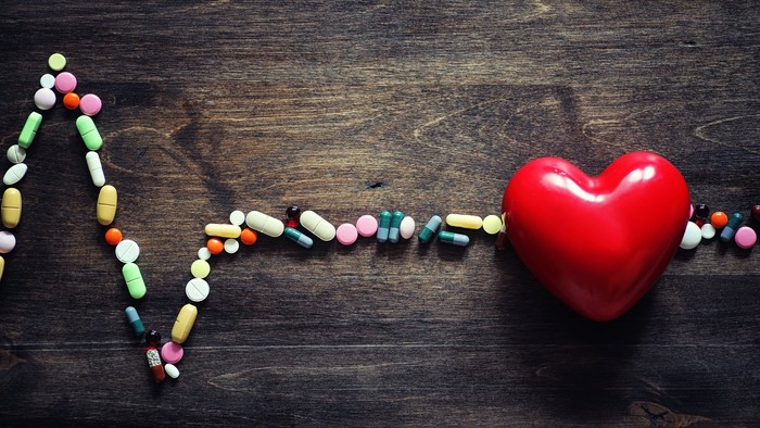 Electrocardiogram made of colorful pills.