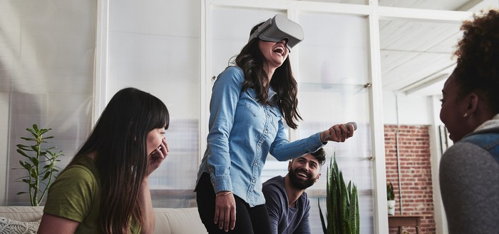 Woman laughing while wearing Oculus Go headset