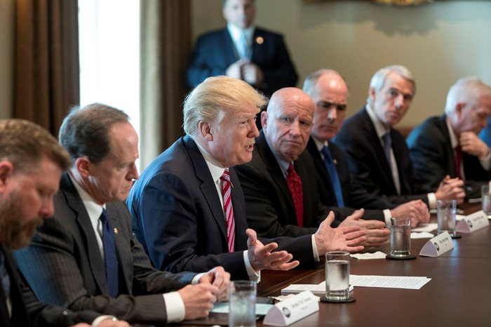 President Trump in meeting with his advisors.