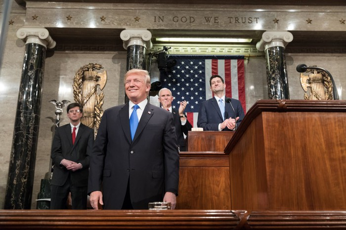 President Trump smiling before giving the State of the Union address in Congress.