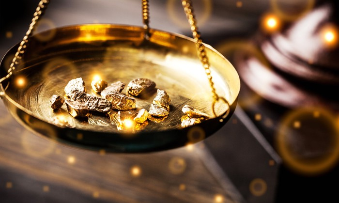 Gold nuggets on an antique scale.