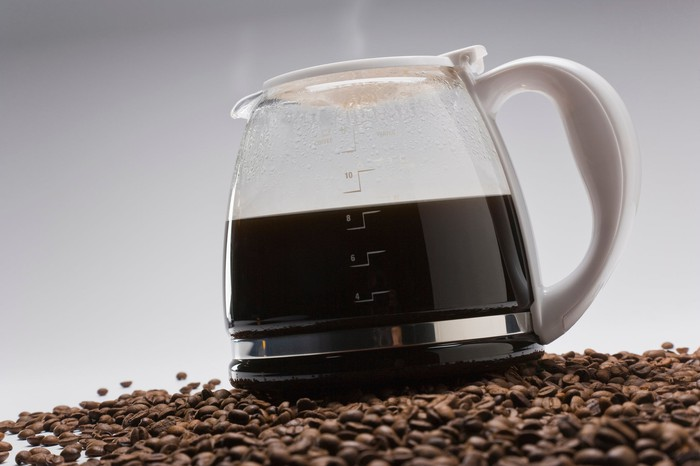 Coffee pot on pile of coffee beans