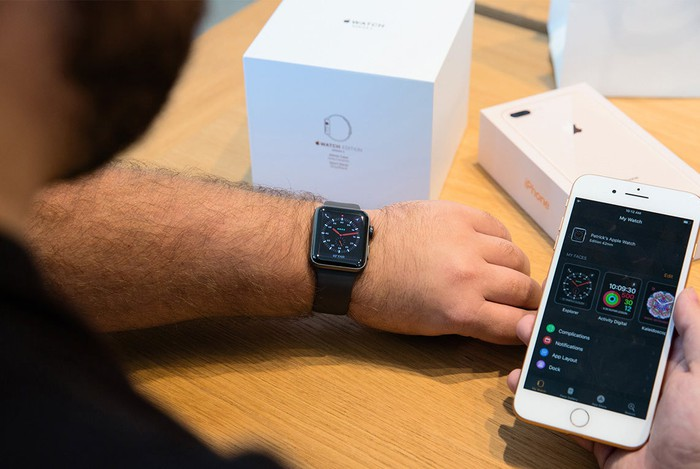 Person setting up and pairing an Apple Watch