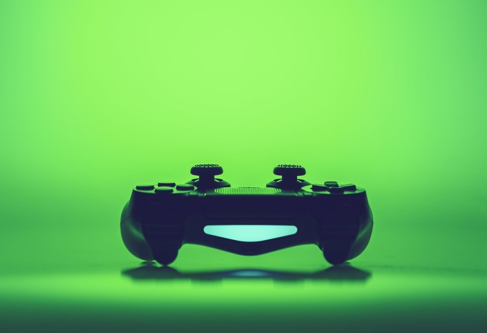 Video game controller with a green background