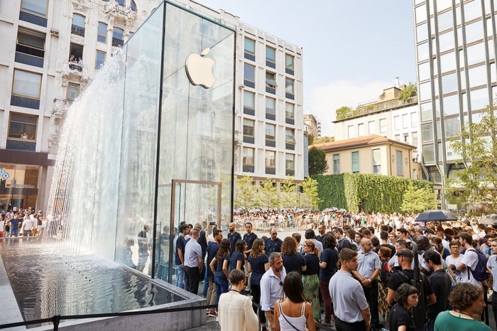A line of customers outside an Apple store in Italy.