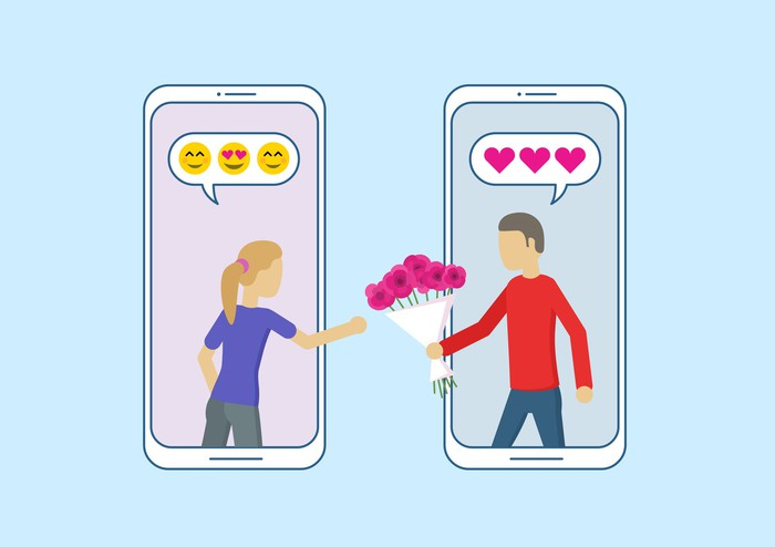 Illustration showing two smartphones side by side with woman reaching out of one and man reaching out of the other with flowers towards the woman.