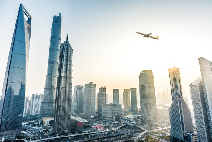 Plane flying over skyscrapers in China