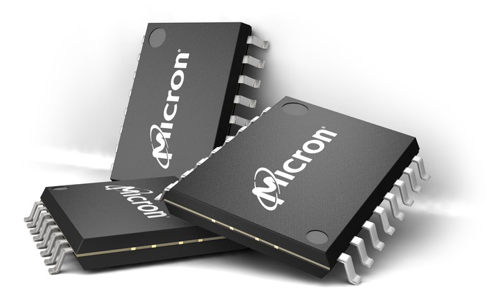 Three memory semiconductor chips with Micron logos on them.