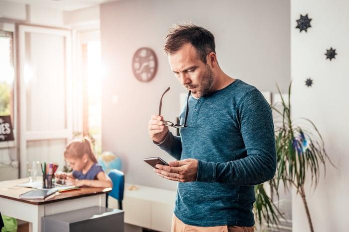 Man looking at smartphone.