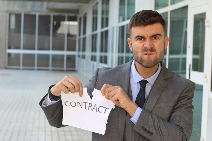 Man ripping up a contract