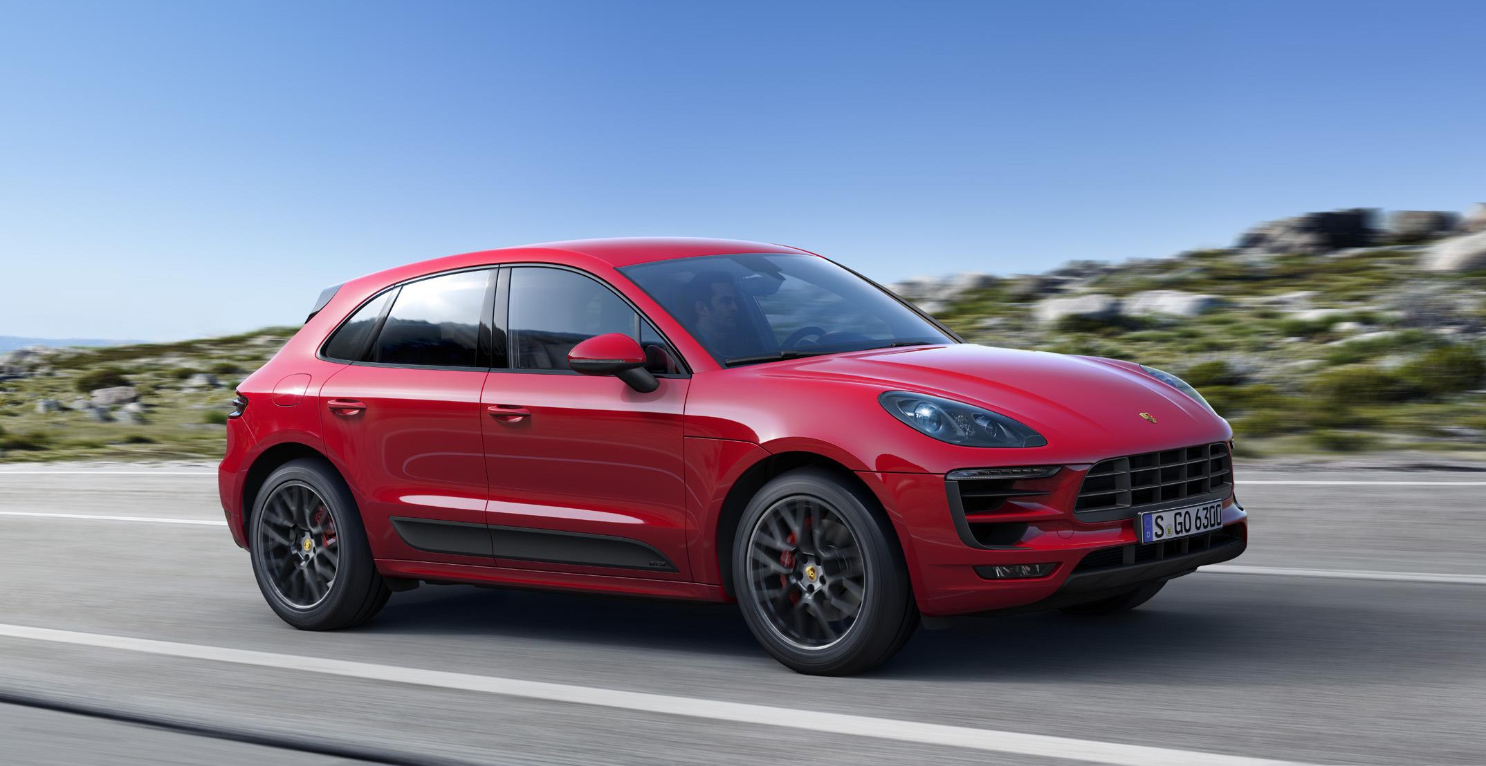 A red 2018 Porsche Macan, a low-slung 5 passenger crossover SUV.