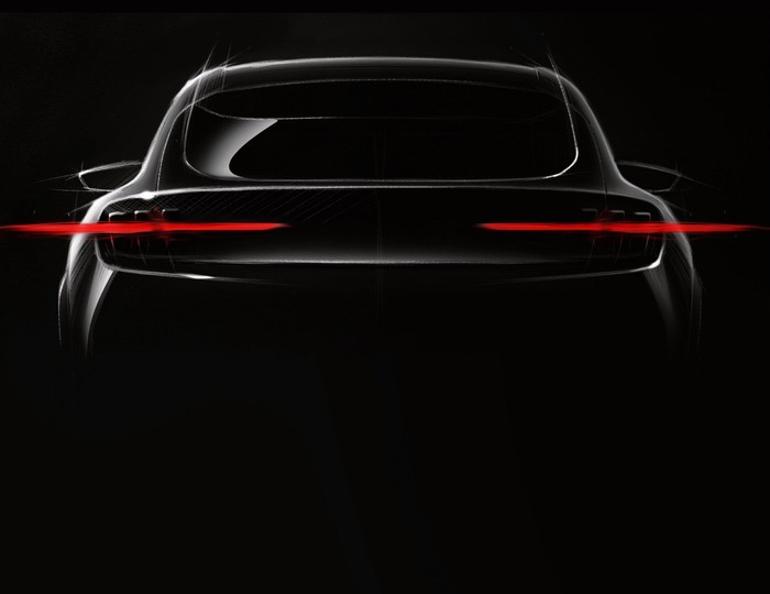 """The rear of a sporty SUV is shown in shadow. We can see """"3 finger"""" taillights inspired by classic Ford Mustangs."""