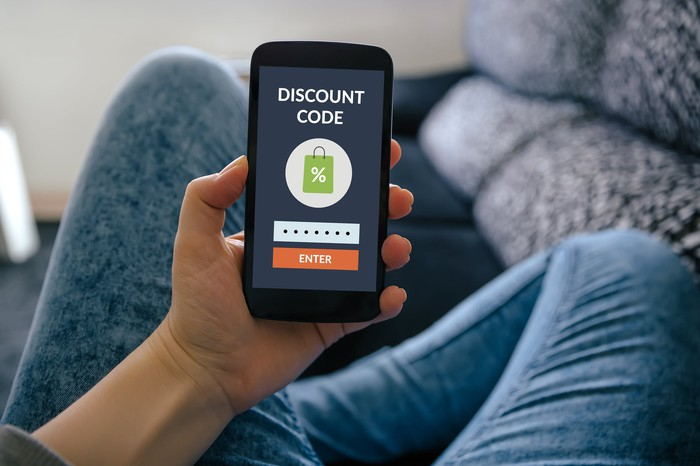 """View of a smartphone screen saying """"Discount Code."""""""