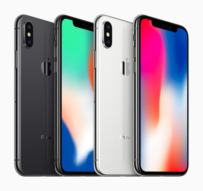 Four iPhone X smartphones in a lineup.