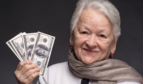 Getty senior older woman money social security retirement delay income wealth