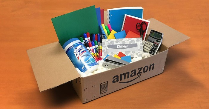 An Amazon box full of office supplies.