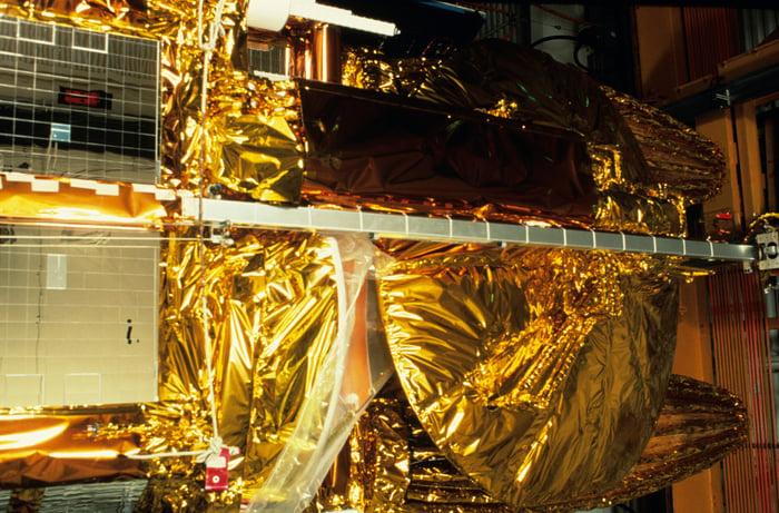 Foil-covered satellite under construction
