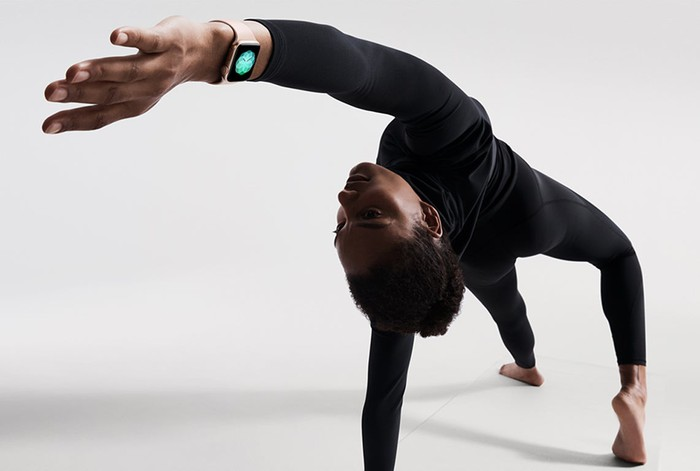 A person doing yoga with an Apple Watch