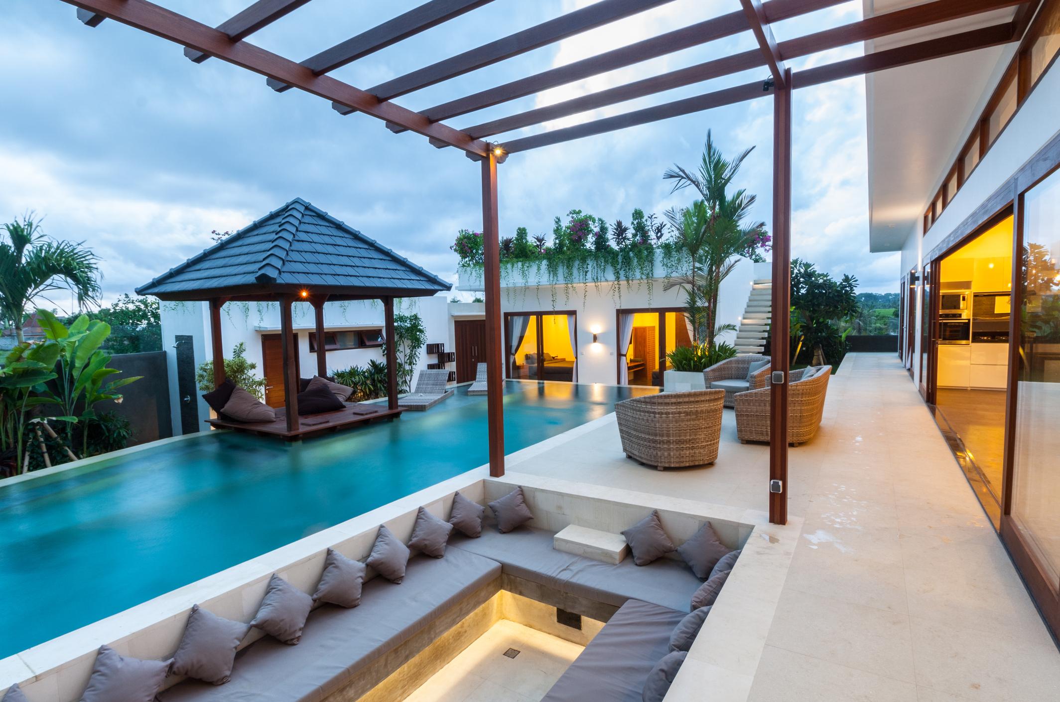Tropical resort villa with a narrow rectangular pool