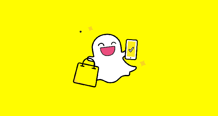 Snap logo of ghost holding mobile device on yellow background.