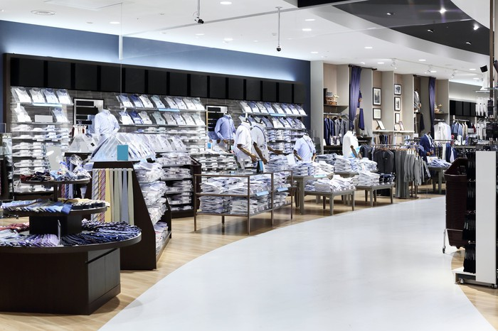 Men's clothing displays in a department store.