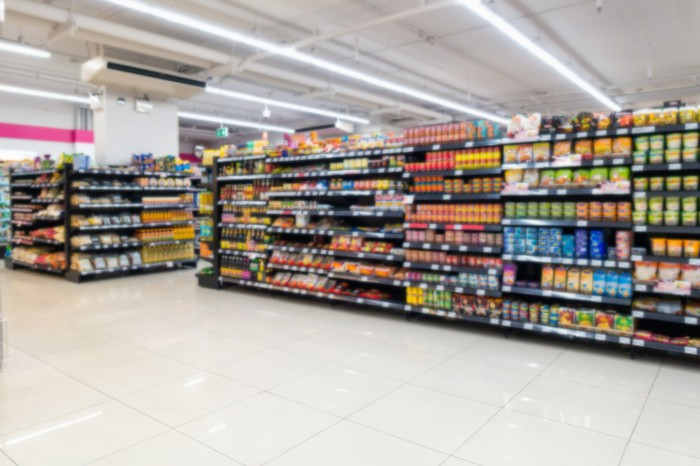 A blurred image of supermarket shelves