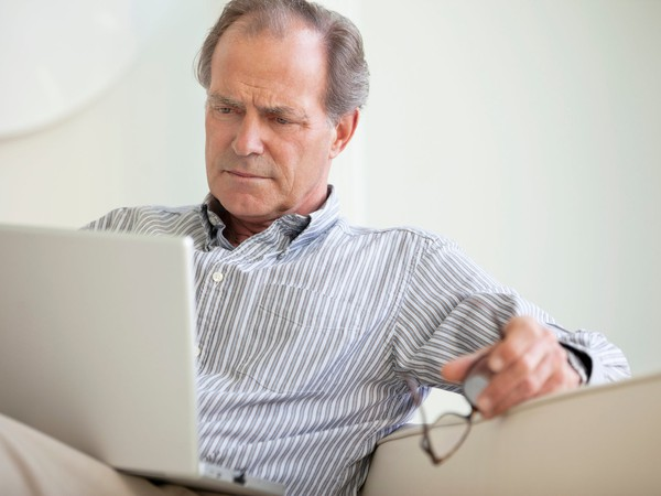 senior man on laptop looking concerned_GettyImages-135385077