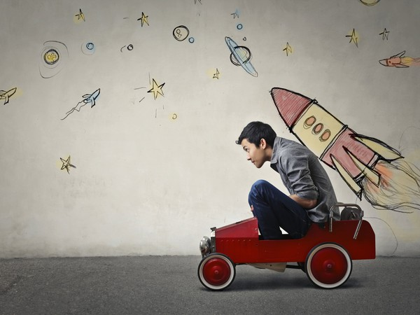 teenage boy in car with rocket on back GettyImages-620402800