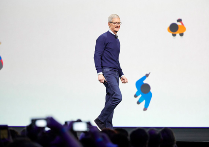 Apple CEO Tim Cook stands on stage at an Apple event.
