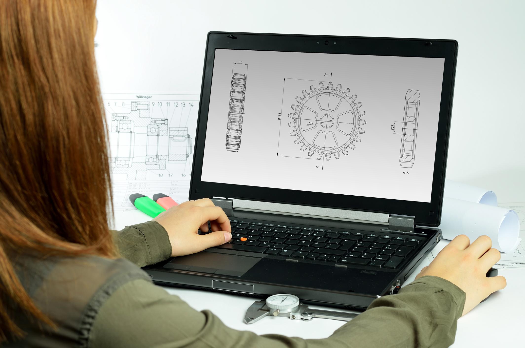 Designer working on CAD program.
