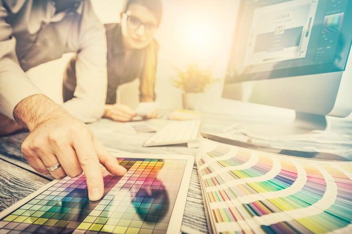 A graphic designer working a graphics editing program.