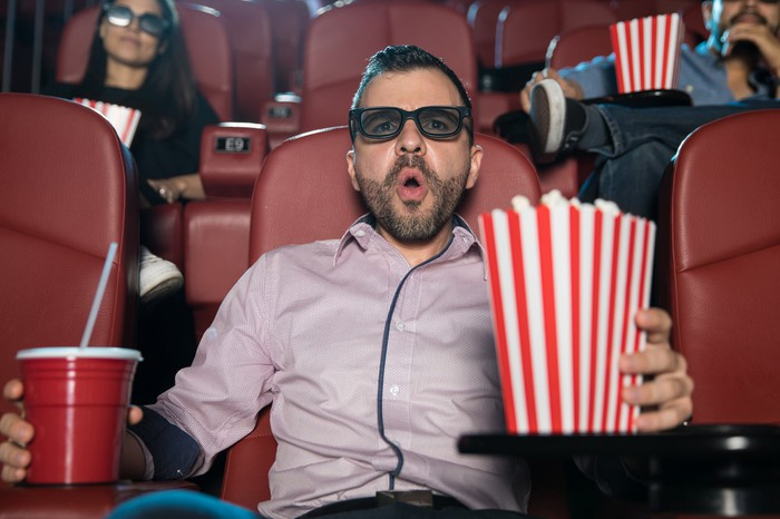 "Man holding popcorn and soda and going ""ooh!"""