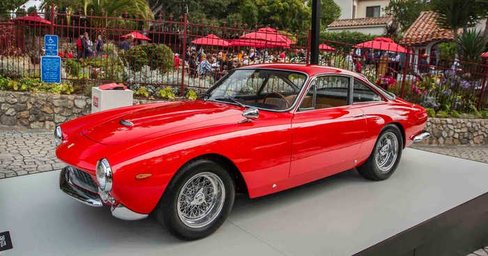 A red Ferrari 250 GT Lusso, a front-engined two-seat model made in 1963 and 1964.