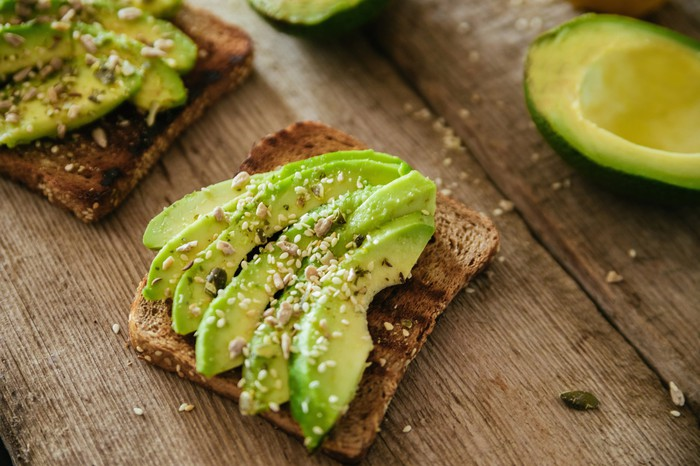 Avocado toast on a wooden table.