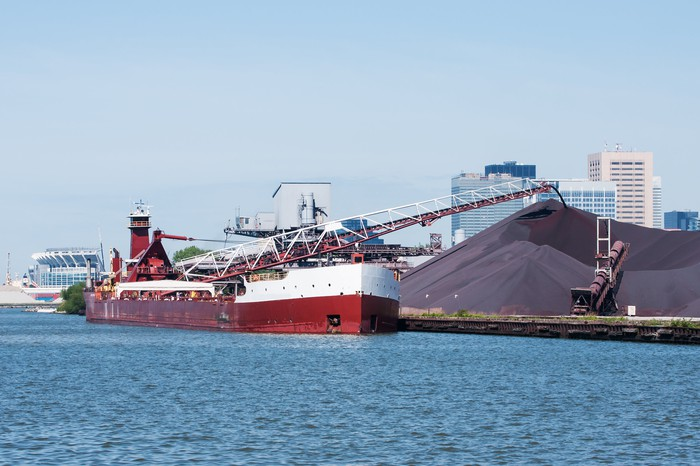 Cargo ship offloading iron ore
