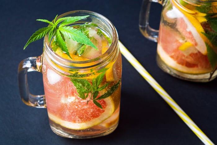 Marijuana leaves in a grapefruit drink.