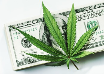 Marijuana with cash Getty Images-marijuana-leaf-on-top-of-stack-of-100-bills