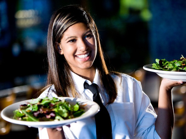 waitress serving salads
