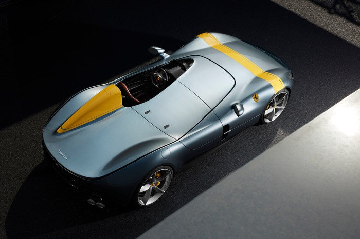 A Ferrari Monza SP1, a single-seat open-top car, silver with yellow racing stripe, viewed from above.