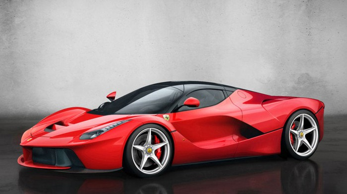 A red LaFerrari hypercar, a two-seat, mid-engine sports car.
