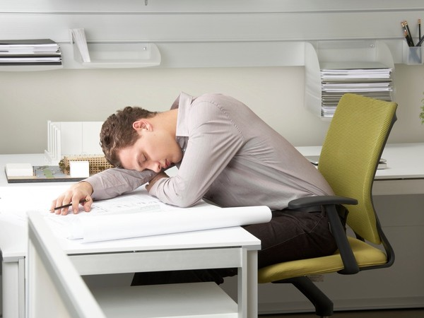 man napping at desk_GettyImages-200331838-001