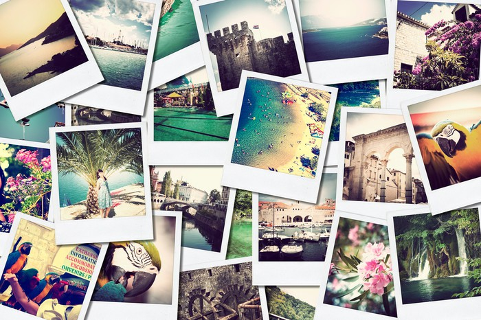 A wall of travel photos.